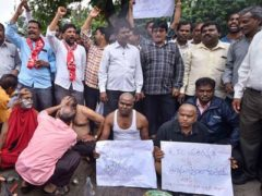 Telangana transport workers get head shaved in protest